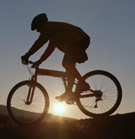 Biker silhouette with sun in background