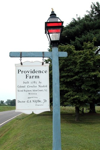 Providence Farm sign on lamp post