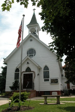 Catholic Church with flag in front